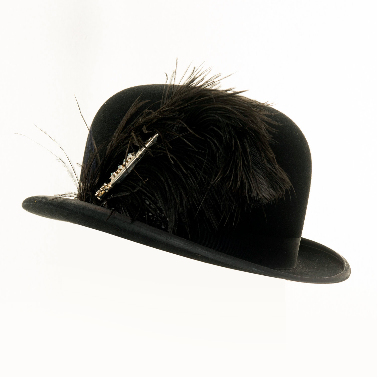 BOWLER HAT WITH FLUTE AND BLACK FEATHER